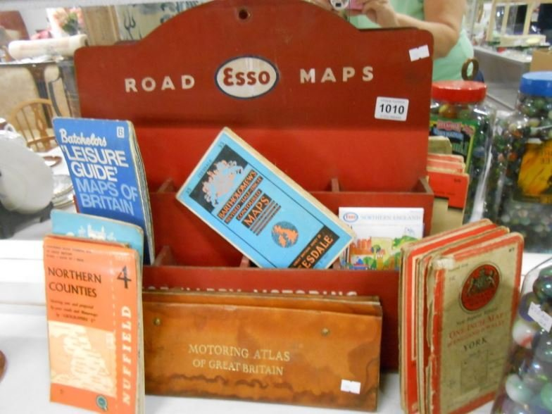 An Esso Road maps stand and maps