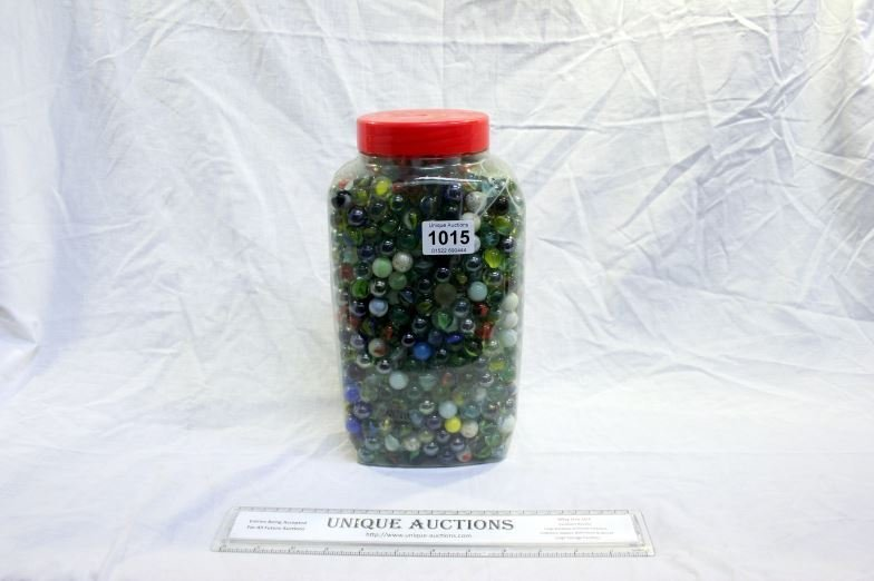 A large jar of coloured glass marbles