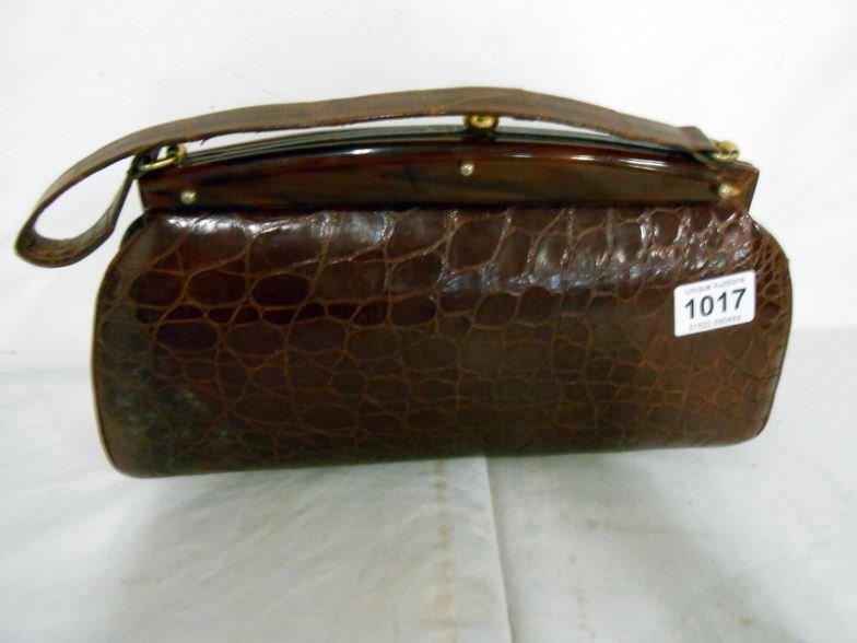 A 'Snakeskin?' handbag with purse