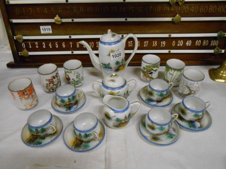 A Japanese porcelain coffee set with Geisha in cups and