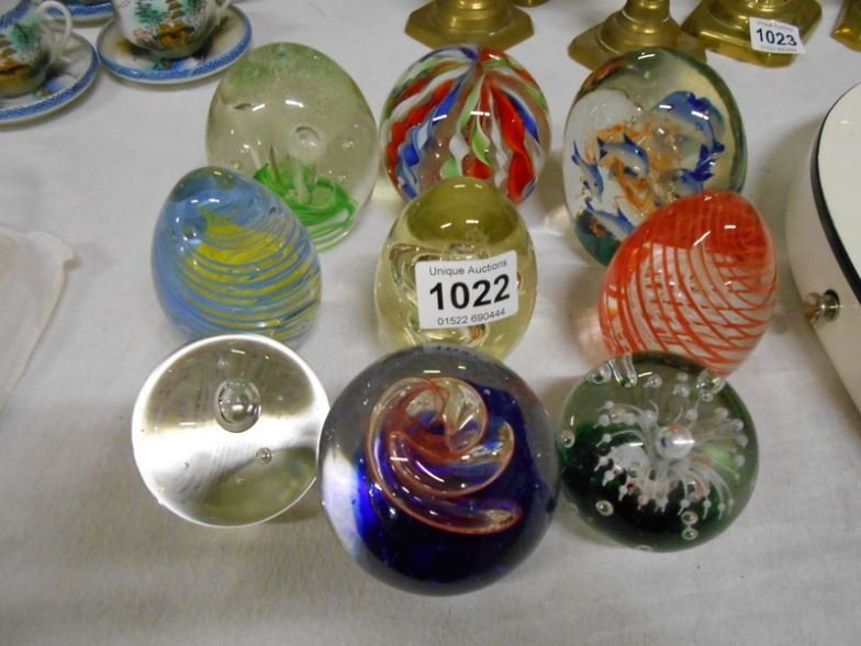 9 glass paperweights