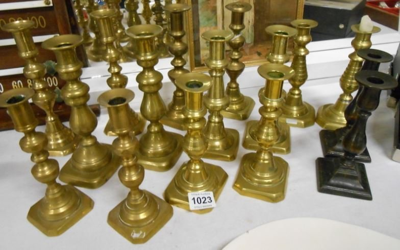8 pairs of brass candlesticks, some Victorian