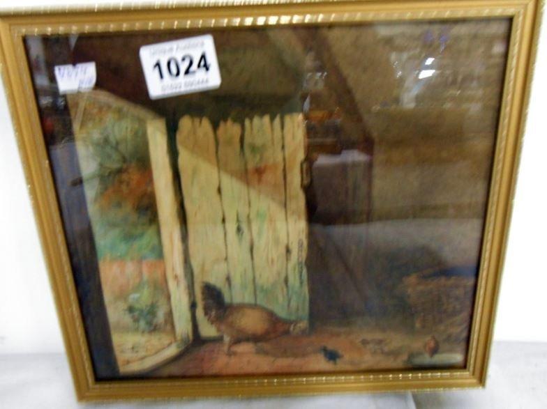 A gilt framed hen house scene