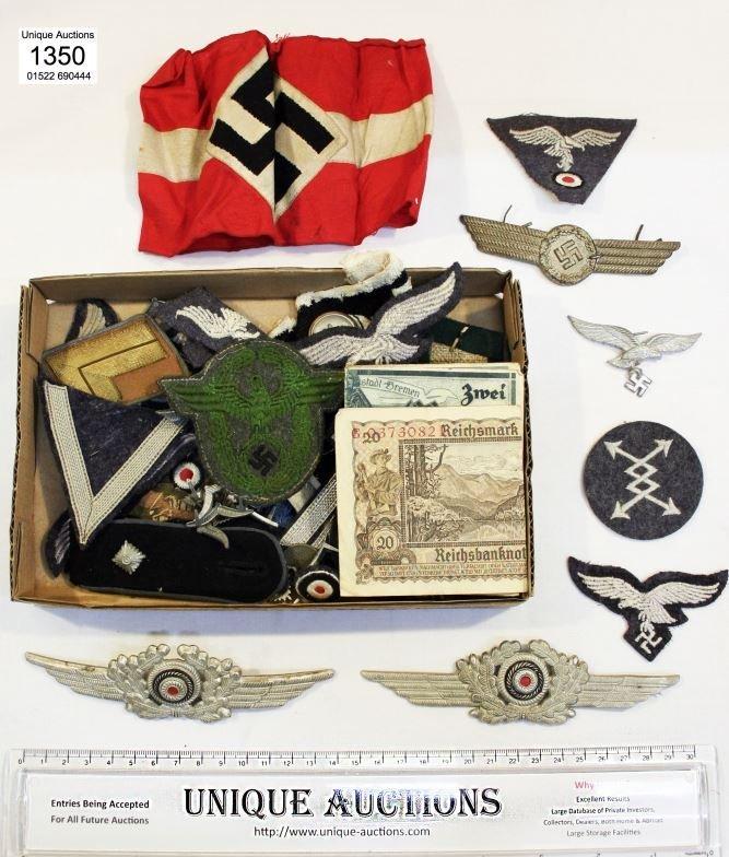 A quantity of German WW2 epaulettes, badges, Nazi armba