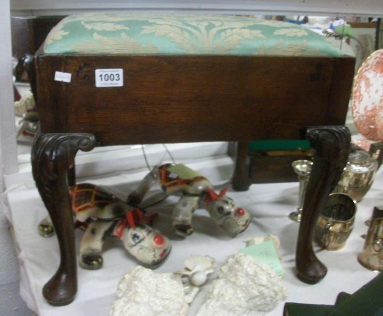 A Queen Anne leg piano stool