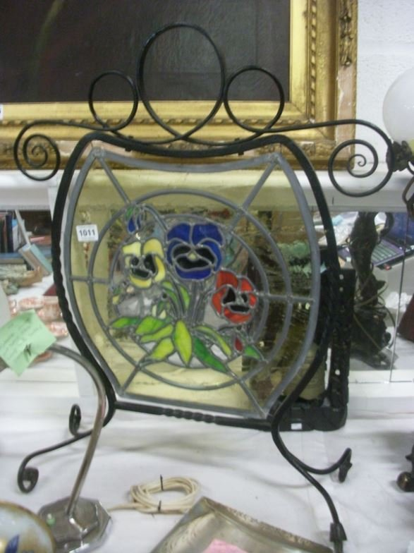A leaded and stained glass fire screen
