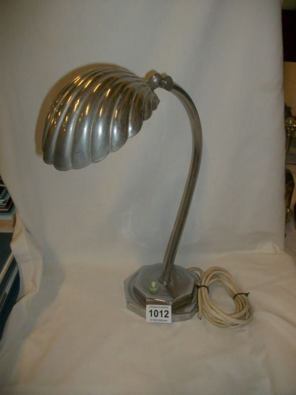 An adjustable art deco table lamp with scallop shade