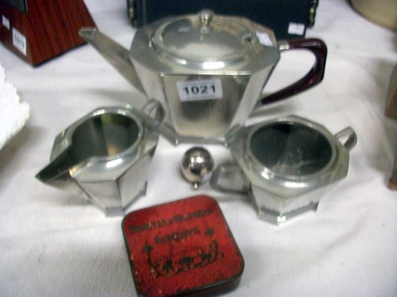 A 3 piece hammered pewter deco style tea set, a Mappin
