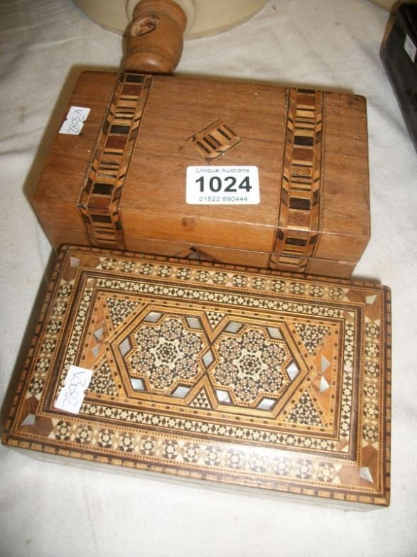 A Victorian inlaid tea caddy and a mother of pearl inla