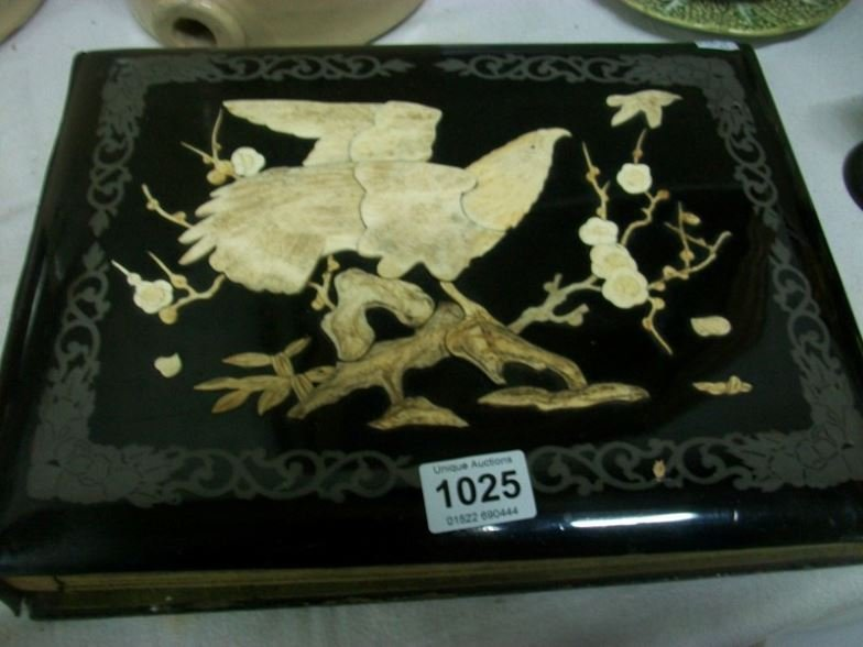 A photo album with ivory decoration