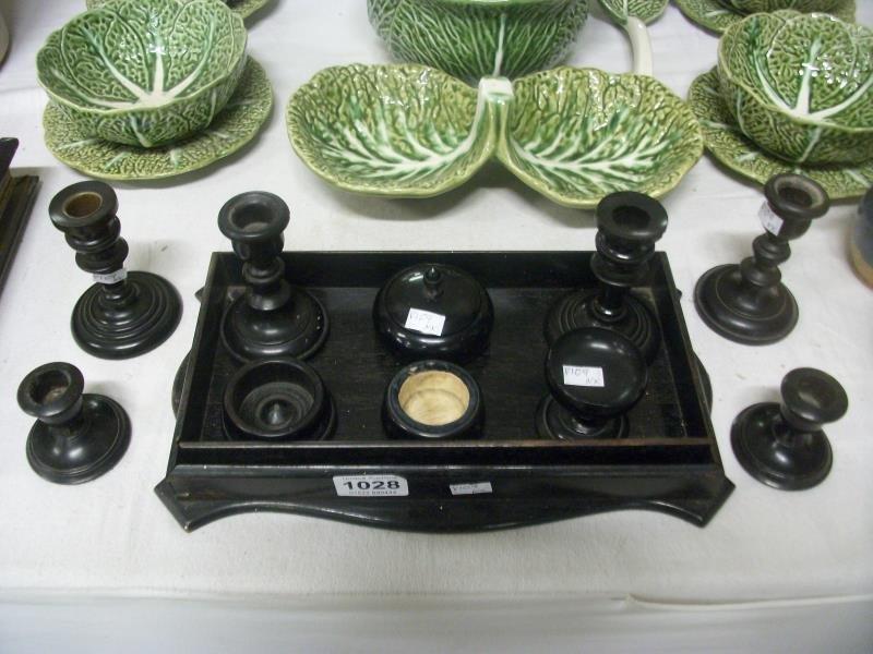 A quantity of ebony candlesticks, tray etc