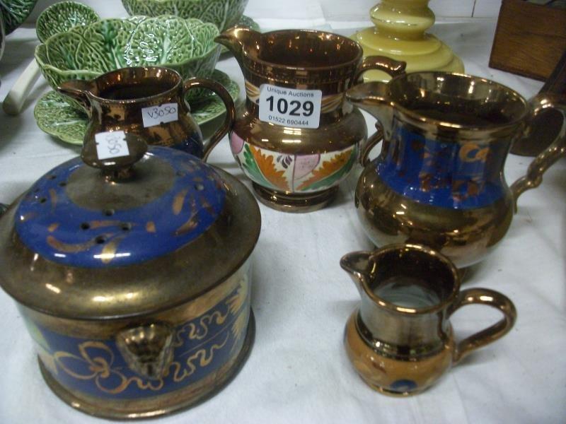 4 Copper lustre jugs and a pot pourri pot