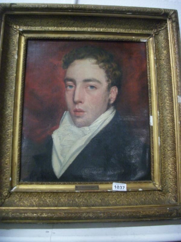 An early 19th century oil on canvas portrait (brass pla
