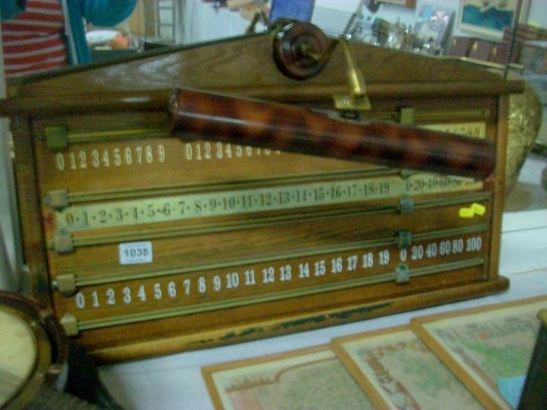 An oak snooker score board with light