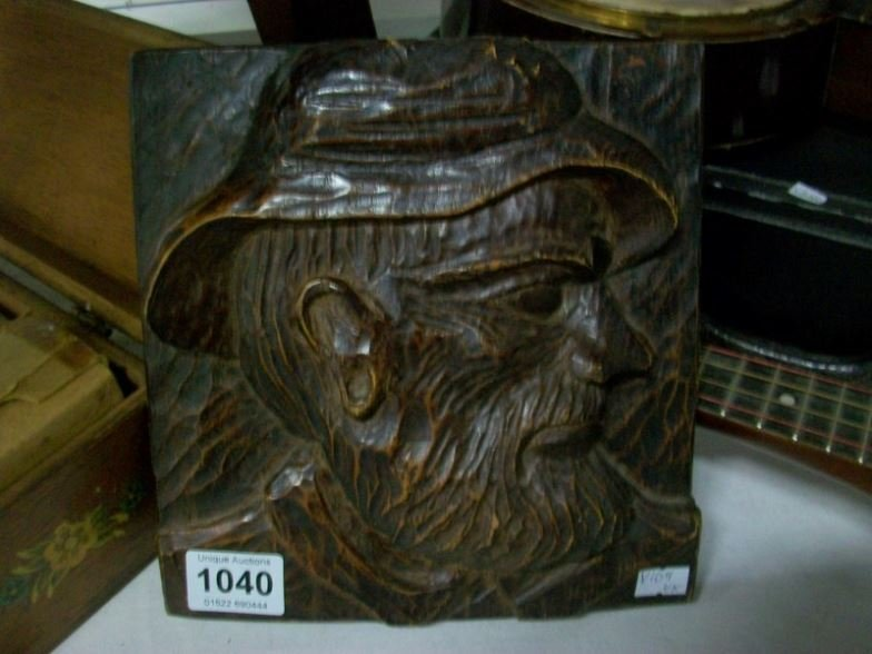 A carved wood plaque