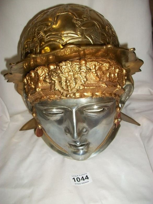 A brass helmet with face plate