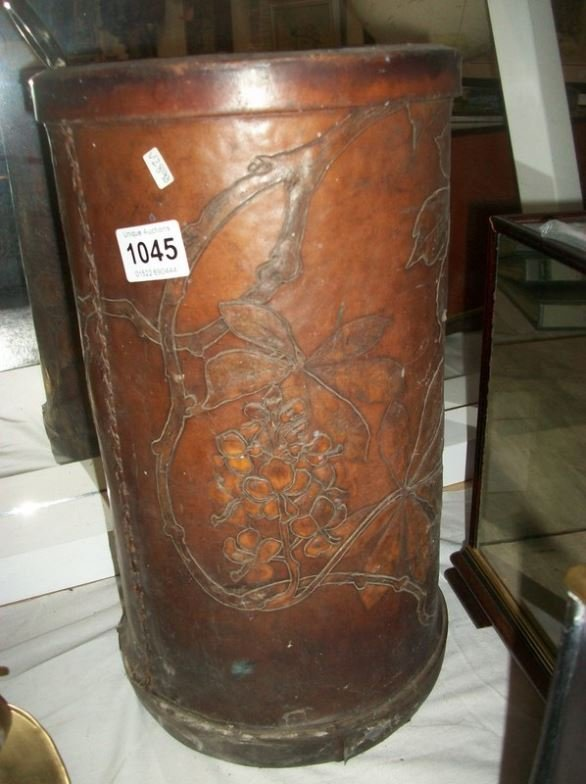 A leather umbrella stand