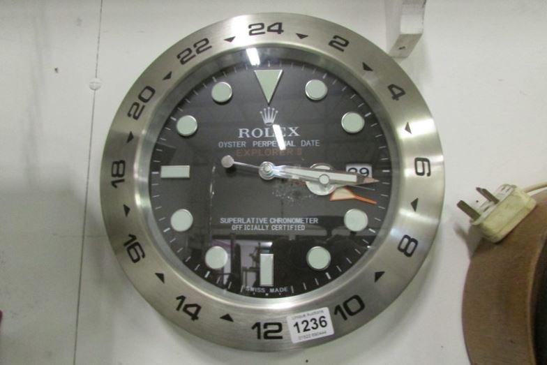 A Rolex dealers display wall clock