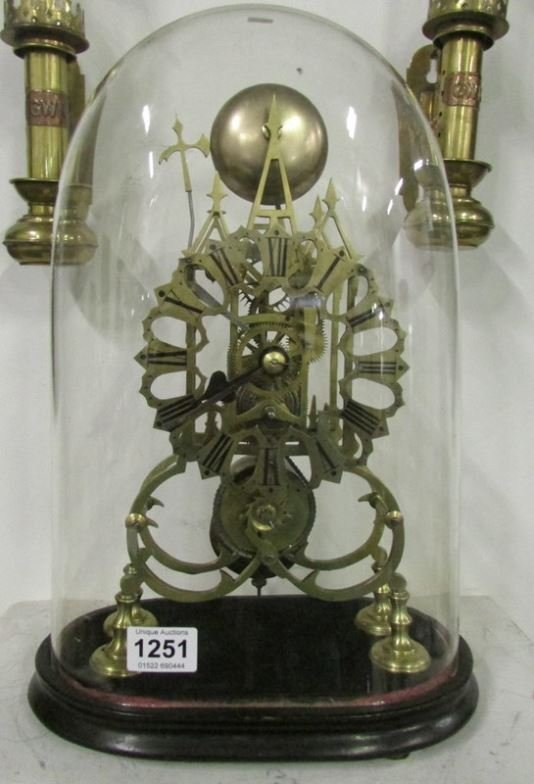 A skeleton clock under glass dome