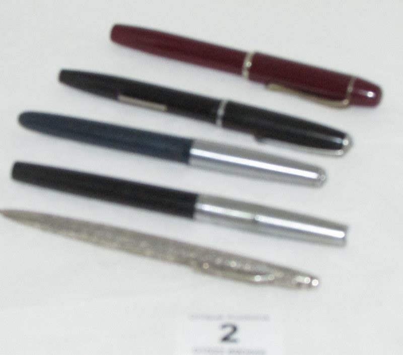4 fountain pens and a silver propelling pencil