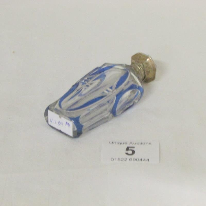 An overlaid scent bottle with continental silver top