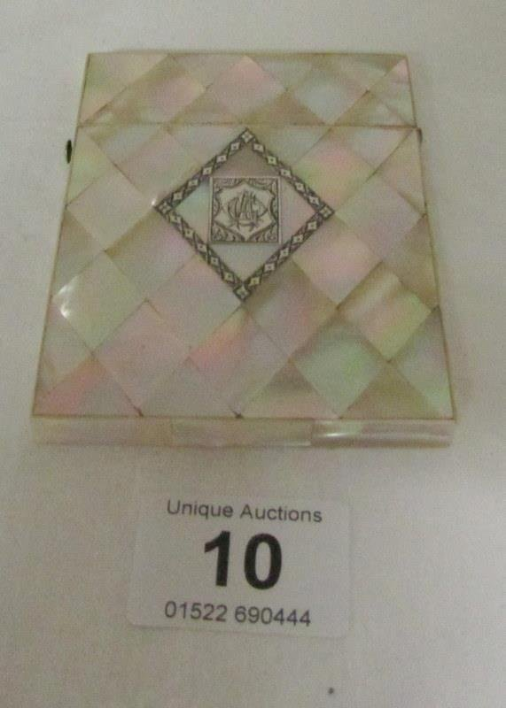 A mother of pearl card case with silver inset