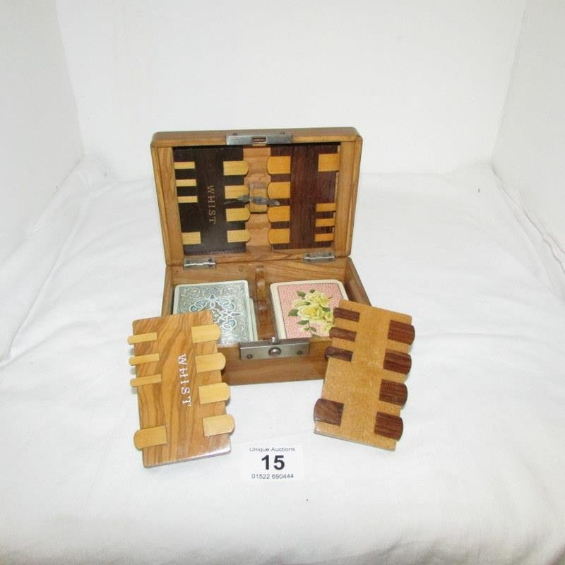 A cased whist set