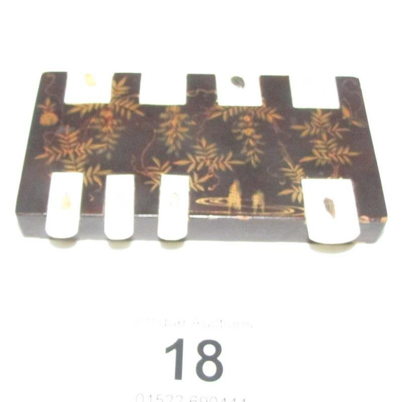 A Chinese lacquered card plaque