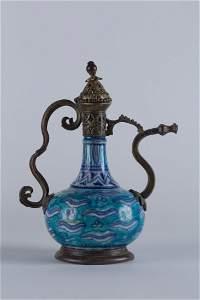 An Iznik bottle with tombak mount