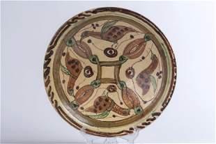 A Sari plate with four birds