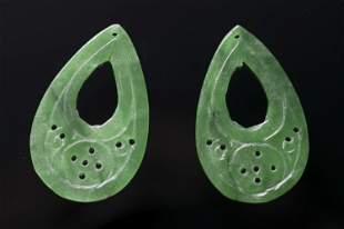 A pair of jadeite jade pendants