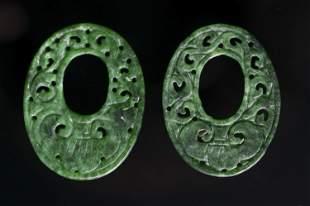 Two oval jadeite jade pendants