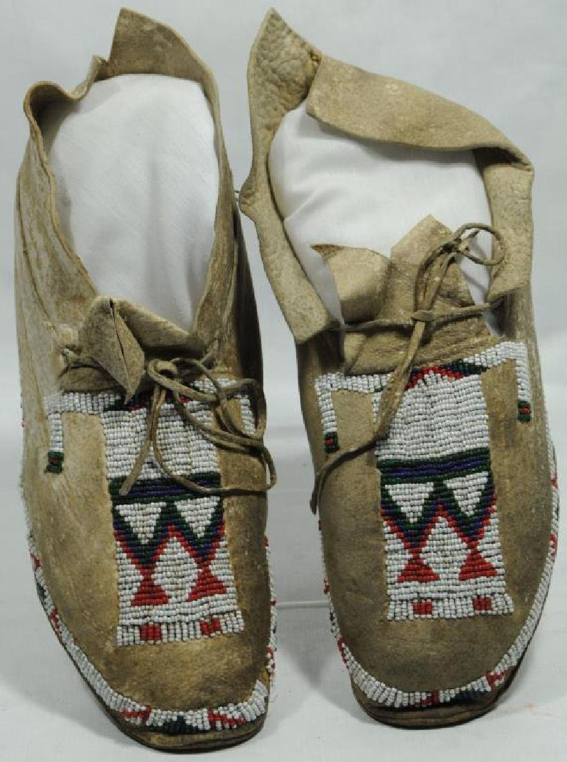 PAIR OF 20TH C. BEADED MOCCASINS WITH HUMAN
