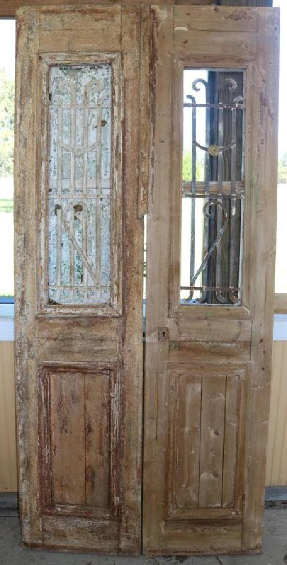 PAIR OF EGYPTIAN DOORS W/ WROUGHT IRON