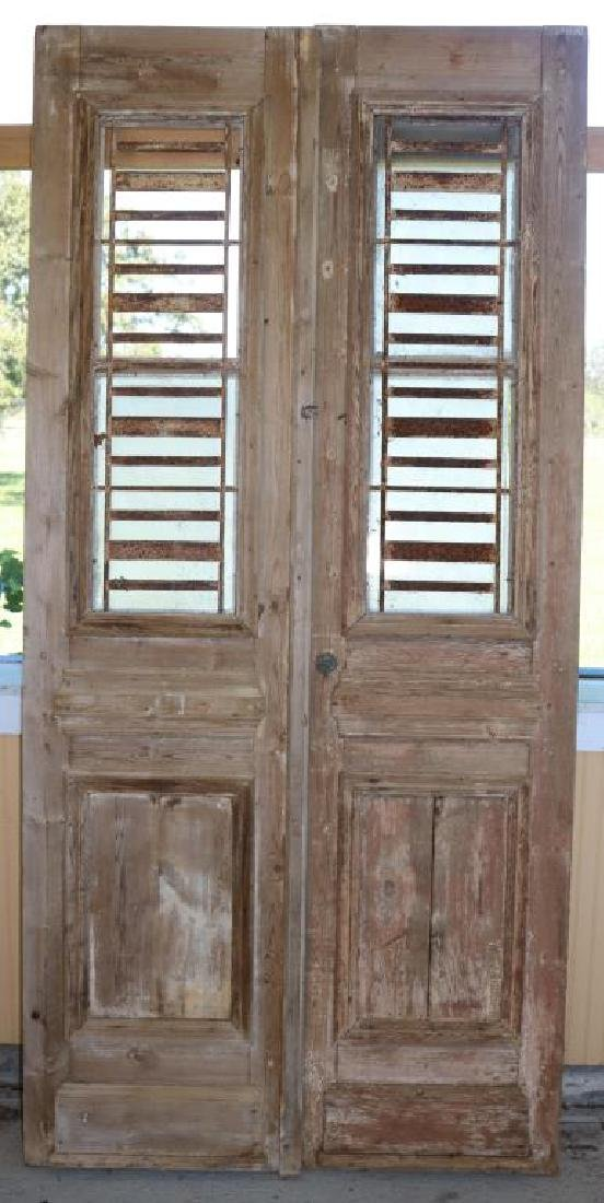 PAIR OF TALL EGYPTIAN DOORS W/ WORN PAINT,