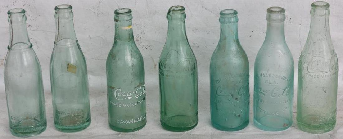 COLLECTION OF 7 VARIOUS STYLE EARLY COKE BOTTLES,