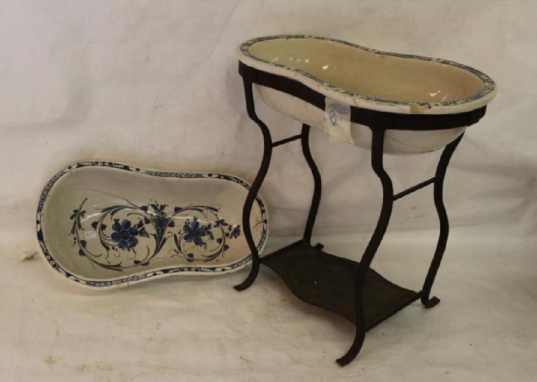 ANTIQUE BLUE AND WHITE BIDET IN IRON STAND,