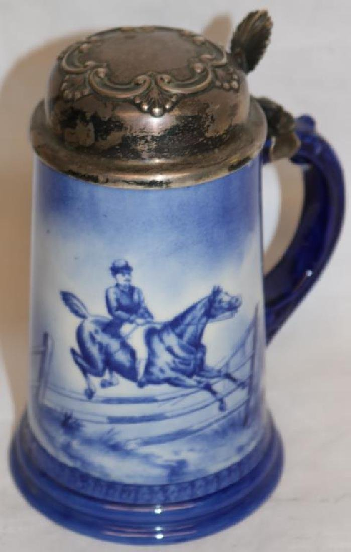 BLUE & WHITE PORCELAIN STEIN W/JUMPING HORSE &