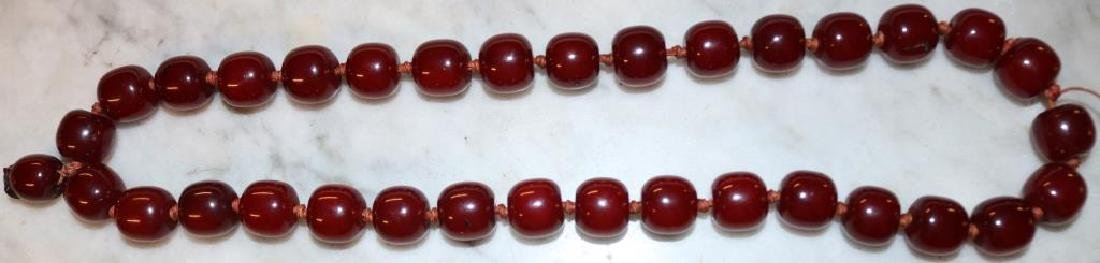 """CHERRY AMBER BEAD NECKLACE APPROX. 24""""L W/ 1/2"""" BE"""