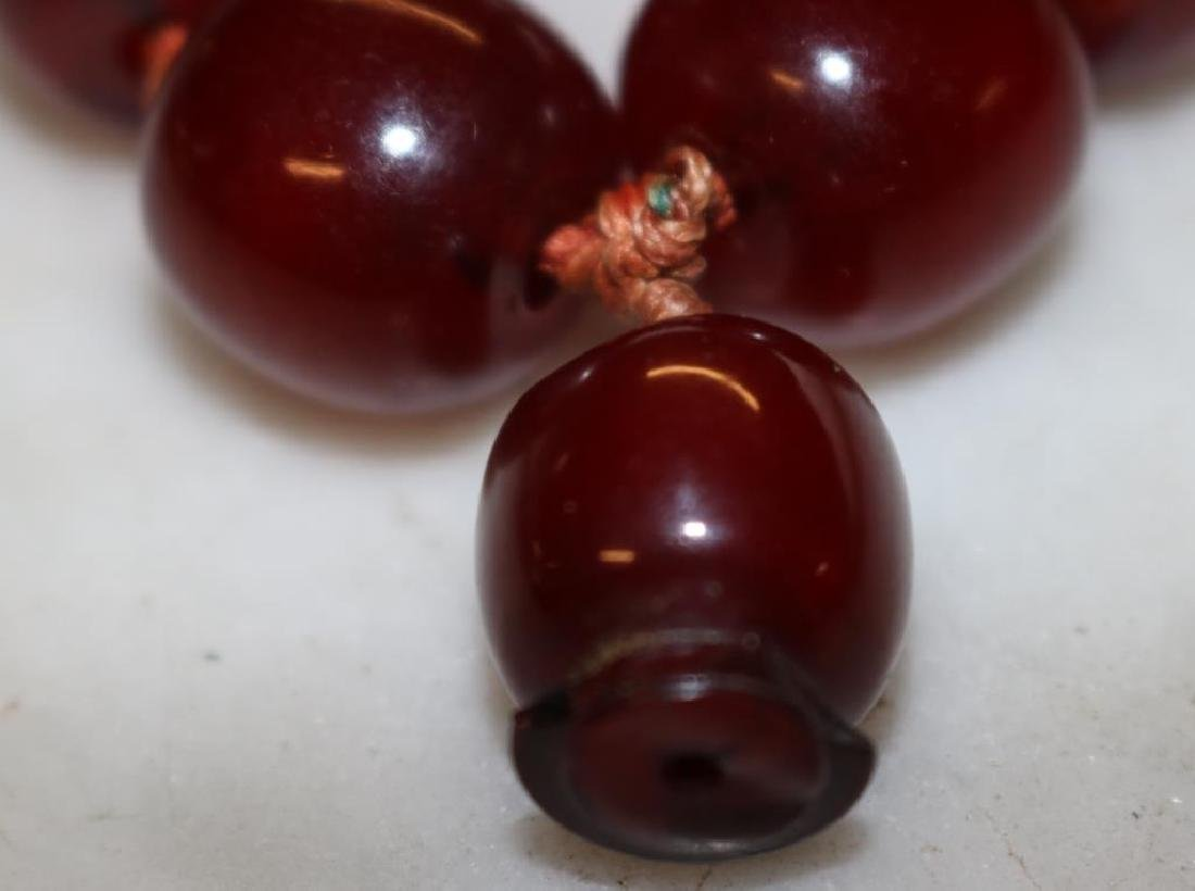 """CHERRY AMBER BEAD NECKLACE APPROX. 24""""L W/ 1/2"""" BE - 3"""