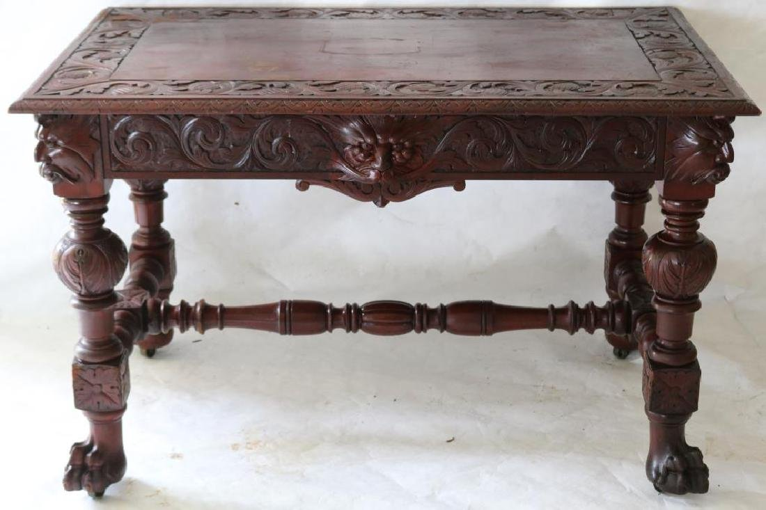 LATE 19TH C. CARVED MAHOGANY LIBRARY TABLE W/