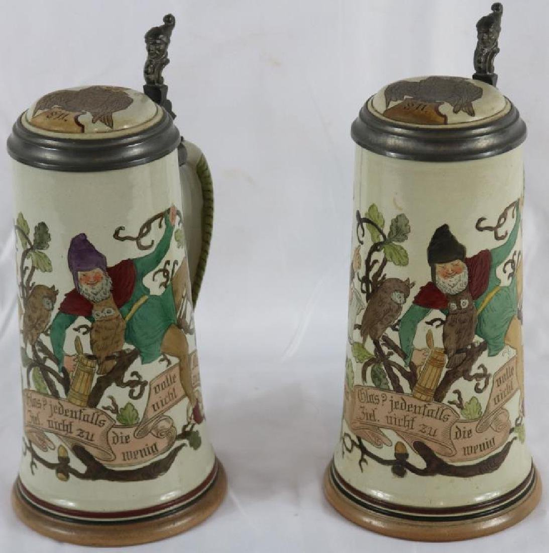 TWO INCISED GERMAN STONEWARE STEINS WITH GNOME &