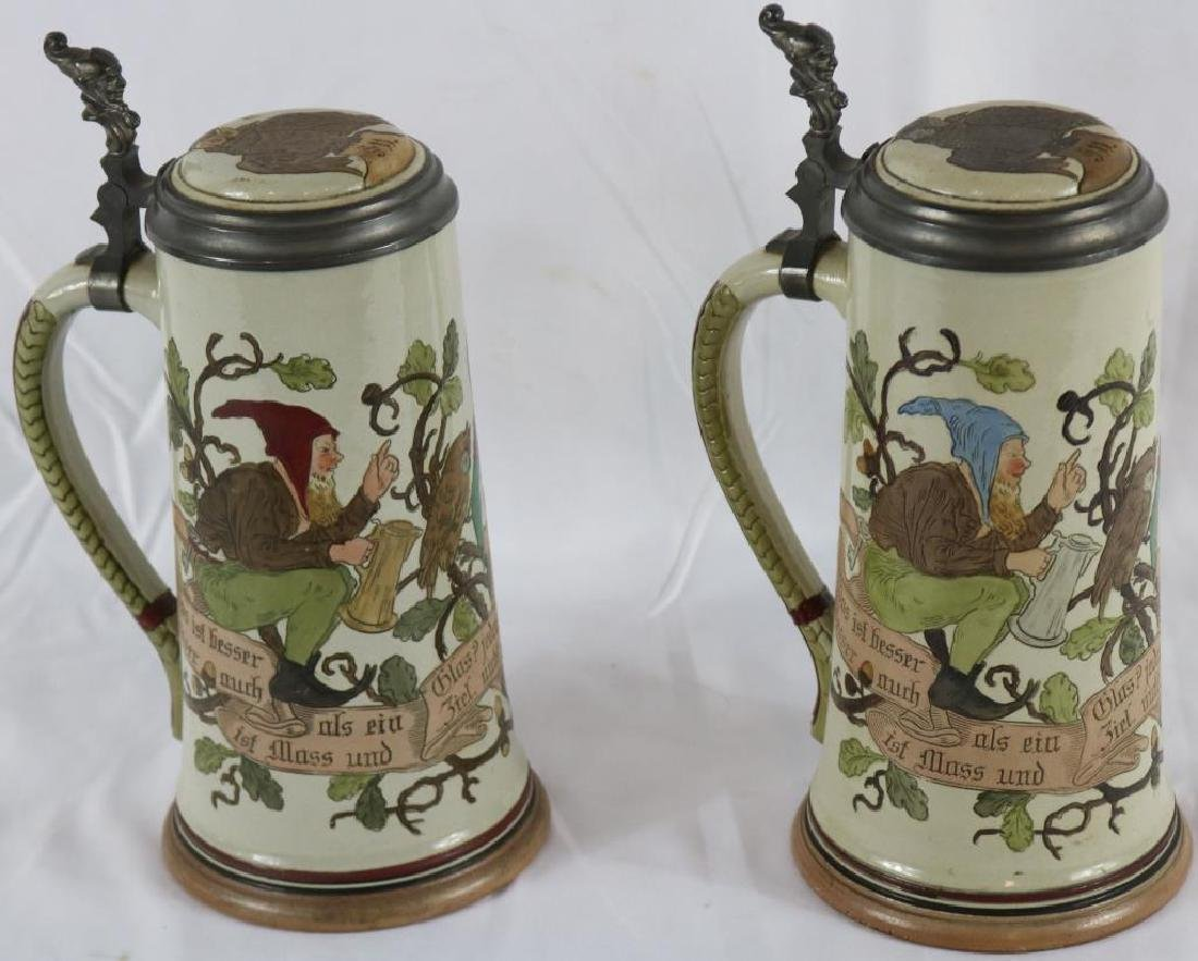 TWO INCISED GERMAN STONEWARE STEINS WITH GNOME & - 2