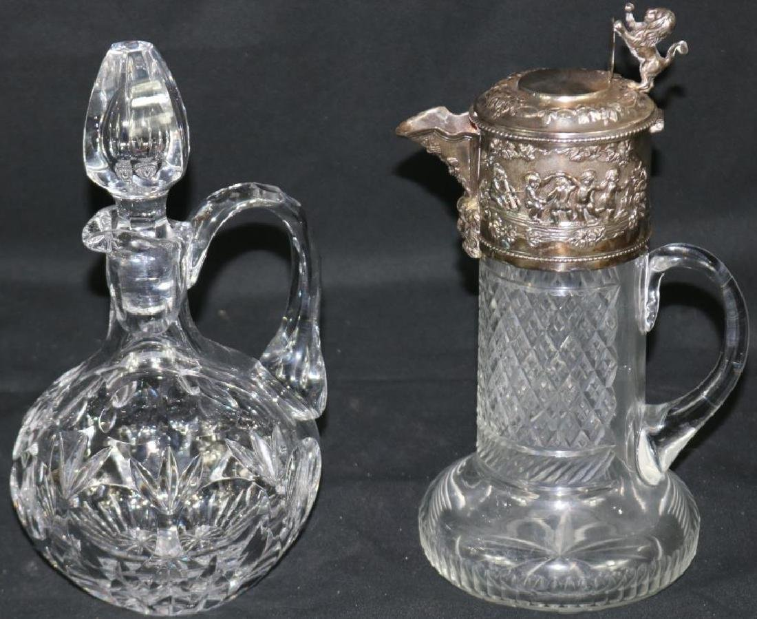 CUT GLASS HANDLED PITCHER WITH ORNATE SILVER