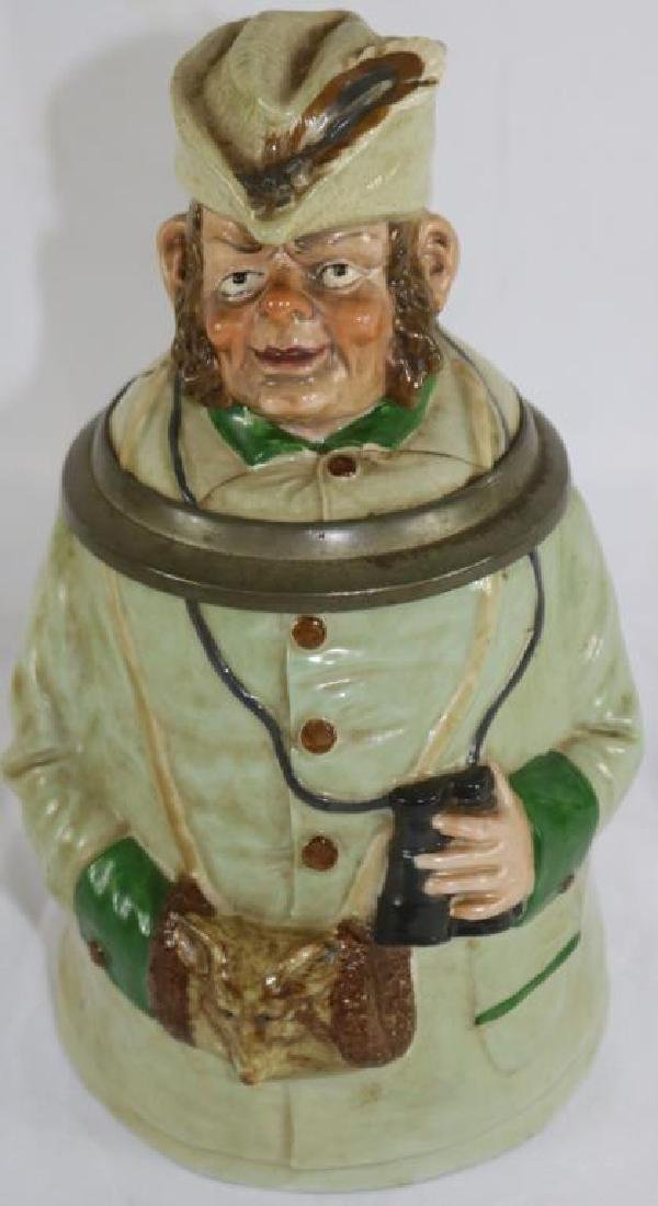 GERMAN PORCELAIN FIGURAL STEIN DEPICTING MAN WITH