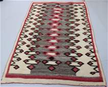 EARLY NAVAJO RUG WITH REPEATING GEOMETRIC DESIGN