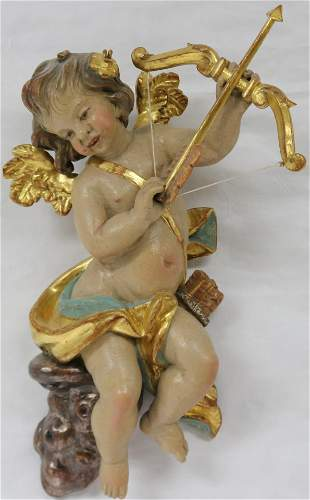 20TH C. CARVED & PAINTED WOODEN CHERUB WITH BOW &