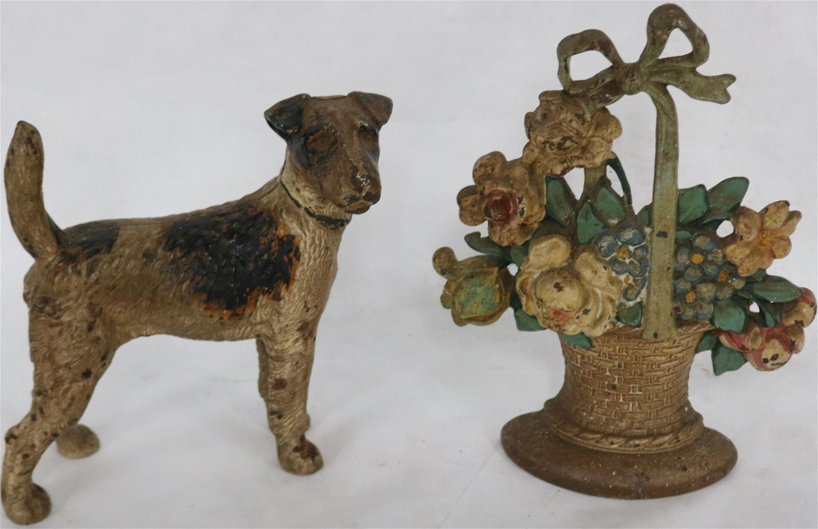 TWO EARLY 20TH C. CAST IRON DOORSTOPS, ORIGINAL