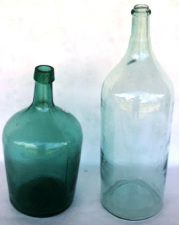 22: 2 LARGE EARLY BOTTLES