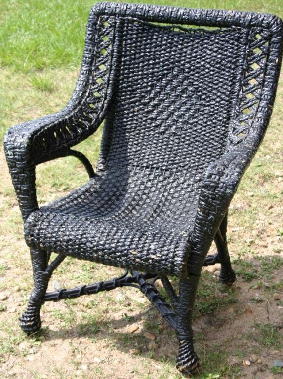 23: OLD WOVEN WICKER ARM CHAIR WITH